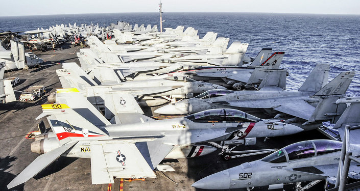 Aircraft line the flight deck of the aircraft carrier USS Ronald Reagan
