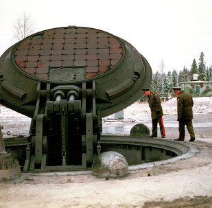 Russian high ranking military officials, look into an opened silo of a Russian intercontinental ballistic Topol-M missile somewhere at undisclosed location in Russia in this 2001 photo