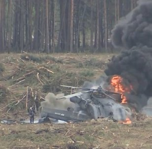 Moment helicopter crashes at airshow in Russia, pilot escapes burning cockpit