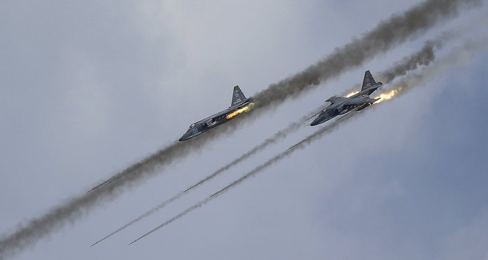 Russian Sukhoi Su-25 Frogfoot ground-attack planes perform during the Aviadarts military aviation competition at the Dubrovichi range near Ryazan, Russia, August 2, 2015