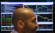 A trader works on the floor of the New York Stock Exchange shortly after the opening bell in New York, July 23, 2015