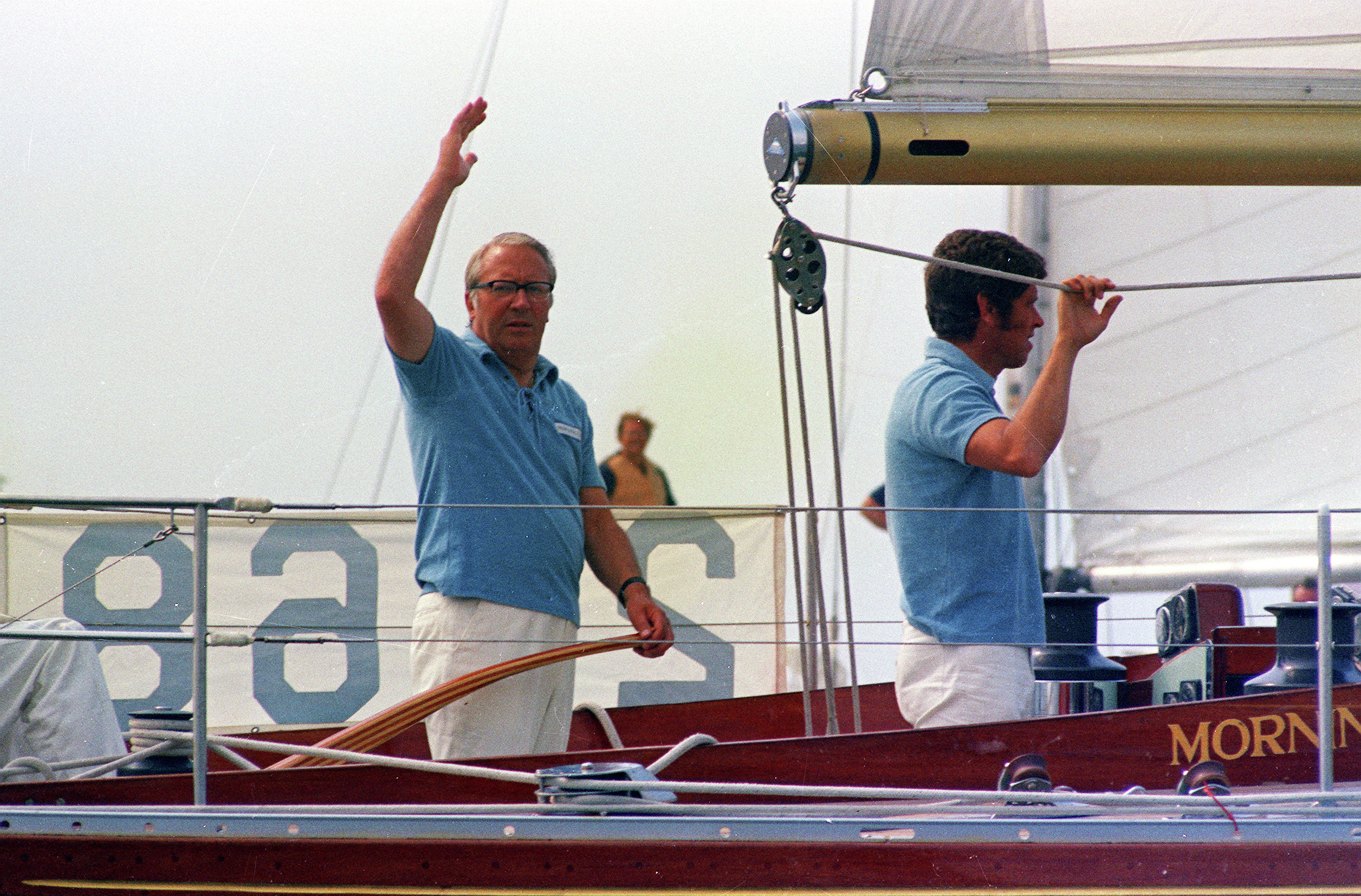 Britain's Prime Minister Edward Heath waves while at the helm of his yacht 'Morning Cloud' during the Admiral's Cup Yacht Race, Cowes, Isle of Wight, England, July 30, 1971