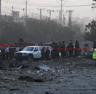 Afghan security forces investigate at the site of a suicide truck bomb attack in Kabul, Afghanistan