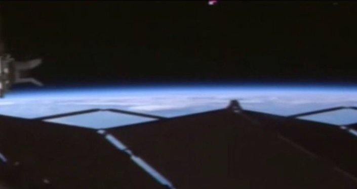 UFO spotted over ISS in NASA live stream footage.