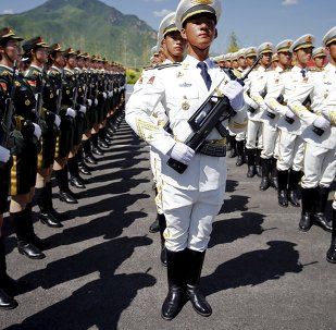 Soldiers of China's People's Liberation Army attend a training session for a military parade to mark the 70th anniversary of the end of World War Two, at a military base in Beijing, China, August 22, 2015