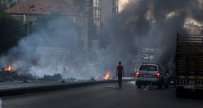 Protestors set uncollected garbage on fire and block a road as they protest against the ongoing refuse crisis in Beirut, Lebanon July 25, 2015.