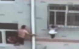 Toddler hanging by her neck four storeys up saved by man with mop in this footage