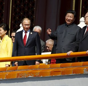 Chinese President Xi Jinping (2nd R) talks to former President Jiang Zemin (R) next to Russia's President Vladimir Putin (2nd L) and South Korea's President Park Geun-hye on the Tiananmen Gate, at the beginning of the military parade marking the 70th anniversary of the end of World War Two, in Beijing, China, September 3, 2015