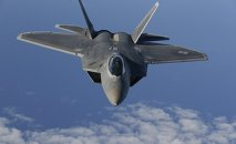 A F-22 Raptor fighter jet of the 95th Fighter Squadron from Tyndall, Florida approaches a KC-135 Stratotanker from the 100th Air Refueling Wing at the Royal Air Force Base in Mildenhall in Britain as they fly over the Baltic Sea towards the newly established NATO airbase of Aemari, Estonia September 4, 2015.