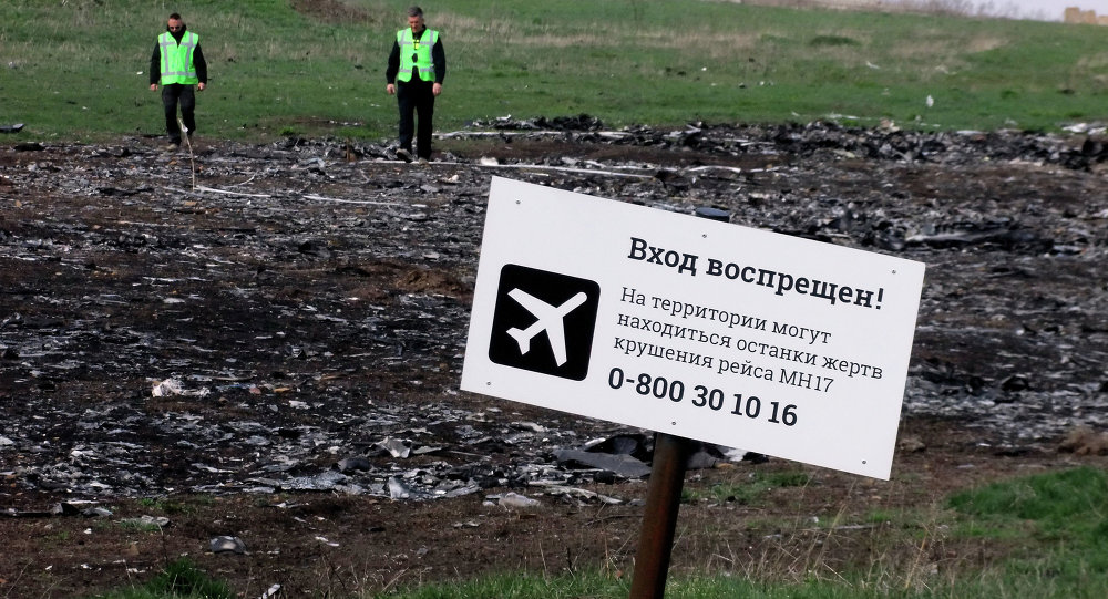 A sign on the crash site of the Malaysia Airlines flight MH17 Boeing en route from Amsterdam to Kuala Lumpur