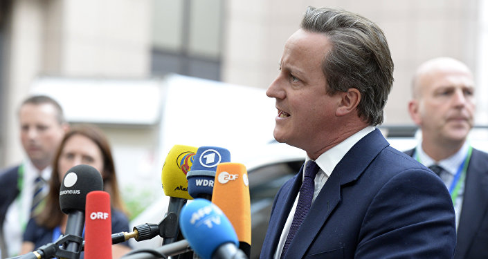 Britain's Prime minister David Cameron talks to journalists as he arrives to attend an European Union (EU) emergency summit on the migration crisis with a focus on strengthening external borders, at the EU Headquarters in Brussels, on September 23, 2015