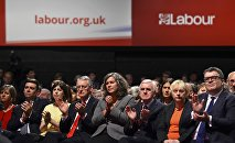 Shadow cabinet members of Britain's Labour Party applaud as leader Jeremy Corbyn delivers his keynote speech at the party's annual conference in Brighton, Britain September 29, 2015