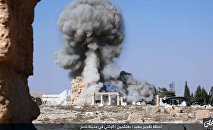 This undated photo released Tuesday, Aug. 25, 2015, file photo, on a social media site used by Islamic State militants, which has been verified and is consistent with other AP reporting, shows smoke from the detonation of the 2,000-year-old temple of Baalshamin in Syria's ancient caravan city of Palmyra
