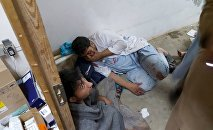 Afghan staff react inside a Medecins Sans Frontieres (MSF) hospital after an air strike in the city of Kunduz, Afghanistan in this October 3, 2015