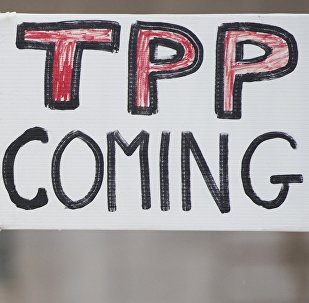 Demonstrators protest against the legislation to give US President Barack Obama fast-track authority to advance trade deals, including the Trans-Pacific Partnership (TPP), during a protest march on Capitol Hill in Washington, DC, May 21, 2015.