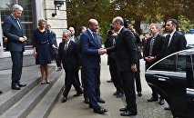Turkey's President Recep Tayyip Erdogan (R) is welcomed by Belgium Prime Minister Charles Michel at Val Duchesse Castle in Brussels on October 6, 2015
