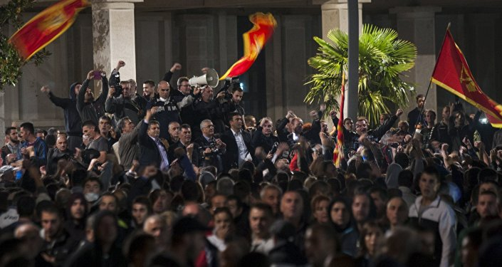 Opposition leaders address demonstrators on the main square during protests in the capital Podgorica, Montenegro, October 18, 2015