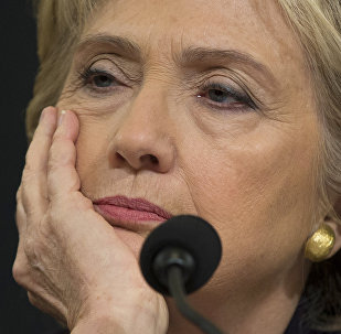 Democratic presidential candidate, former Secretary of State Hillary Rodham Clinton listens while testifying on Capitol Hill in Washington.