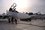 Ground crew prepare fighter jets for combat sorties at Hemeimeem airbase, Syria, Thursday, Oct. 22, 2015