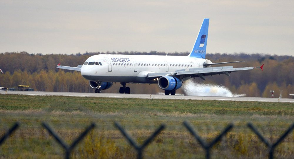 In this photo taken on Tuesday, Oct. 20, 2015, The Russian airline Kogalymavia's Airbus A321 with a tail number of EI-ETJ on an airstrip of Moscow's Domodedovo international airport, outside Moscow, Russia