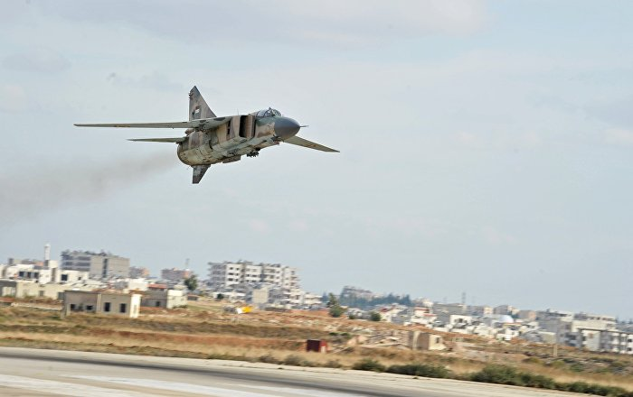 The Soviet-made MiG-23 fighter of the Syrian Air Force flies over the Hama airbase