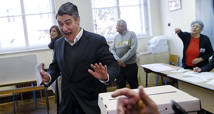 Leader of the Social Democratic Party (SDP) Zoran Milanovic reacts before casting his vote at a polling station during parliamentary election in Zagreb, Croatia, November 8, 2015