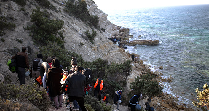 Migrants arrive to travel by dingny from the Turkish coast to the Greek island of Chios, near Cesme, Turkey, Monday, Nov. 9, 2015.