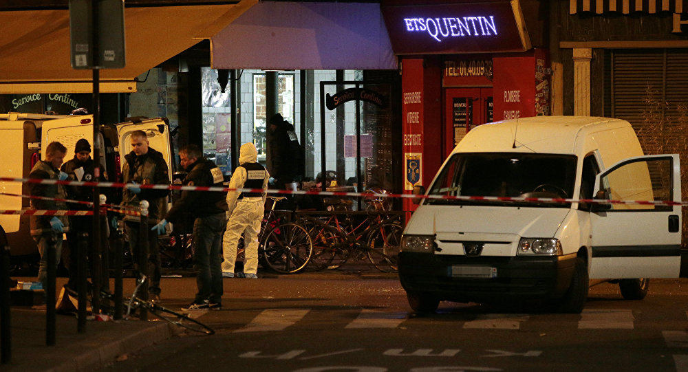 Forensic police search for evidences outside the La Belle Equipe cafe, rue de Charonne, at the site of an attack on November 14, 2015 in Paris, after a series of gun attacks occurred across the city. More than 100 people were killed in a mass hostage-taking at a Paris concert hall and many more were feared dead in a series of bombings and shootings, as France declared a national state of emergency