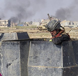 Iraq forces supported by U.S.-led coalition airstrikes advance their position during clashes with Islamic State group in the western suburbs of Ramadi, the capital of Iraq's Anbar province.