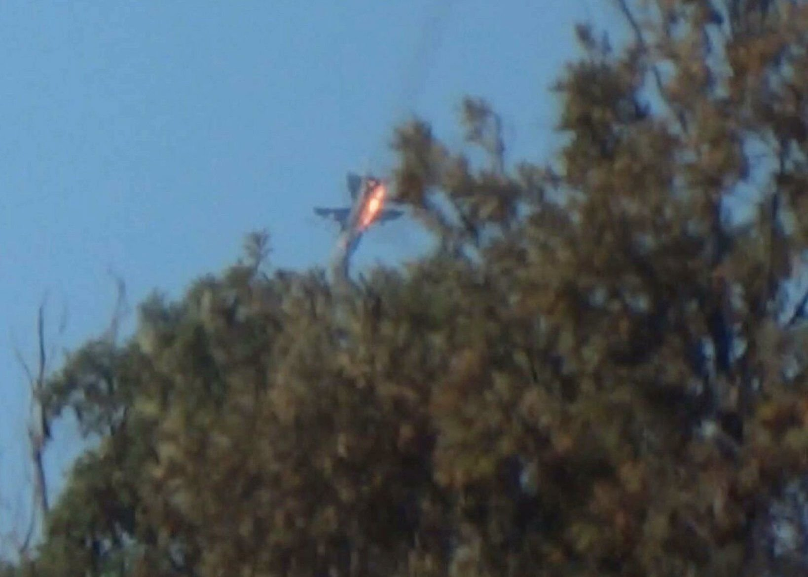 The Russian Su-24 bomber crashes in flames in a mountainous area in northern Syria after it was shot down by Turkish fighter jets near the Turkish-Syrian border November 24, 2015.