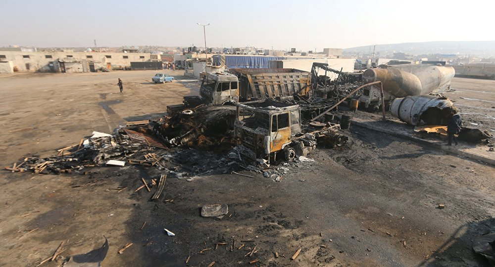 A general view shows damaged trucks after what activists said were air strikes carried out by the Russian air force, on a parking garage for cargo trucks in al-Dana town, near the Syrian-Turkish border in Idlib Governorate November 28, 2015
