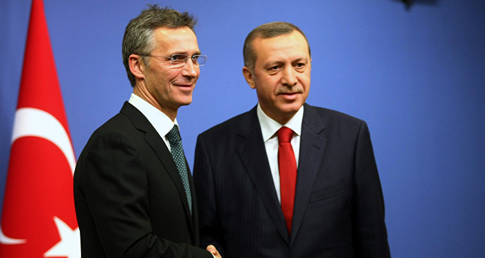 Jens Stoltenberg shakes hands with Recep Tayyip Erdogan