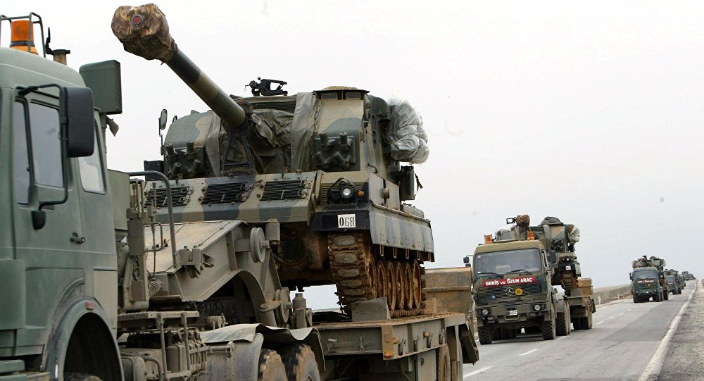 A large convoy of Turkish military including tanks and ambulances rolls  from the southeastern part of Turkey toward the Iraqi border (File)