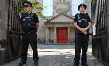 Police are seen outside Canongate Kirk in Edinburgh, Scotland