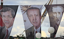 Banners from left to right show Turkish Prime Minister Ahmet Davutoglu, also leader of the Justice and Development Party (AKP); Turkey's current President Recep Tayyip Erdogan' and Turkish Republic founder Mustafa Kemal Ataturk