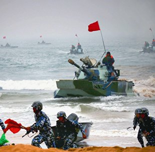 Chinese amphibious tanks and marines storm a beachhead in an amphibious assault drill during the third phase of the Sino-Russian joint military exercise