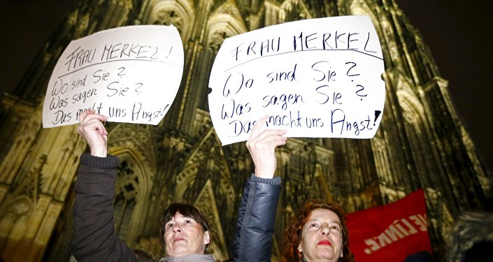 Women hold up placards that read Mrs. Merkel: Where are you? What are you saying? This worries us! during a protest in front of the Cologne Cathedral, Germany, January 5, 2016