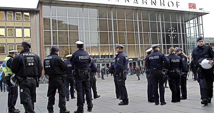 Police officers patrol in front of the main station of Cologne, Germany, on Wednesday, Jan. 6, 2016.