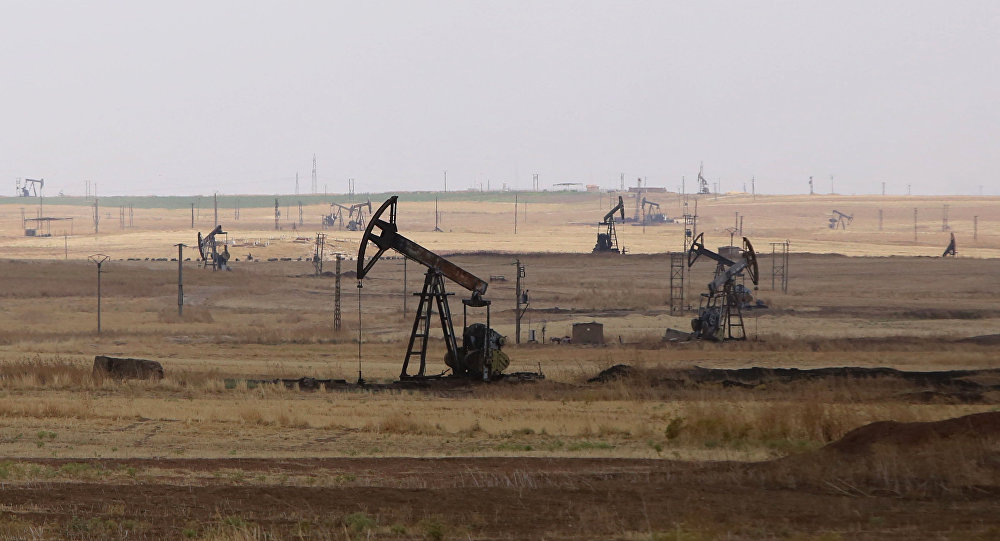 Oil well pumps are seen in the Rmeilane oil field in Syria's northerneastern Hasakeh province
