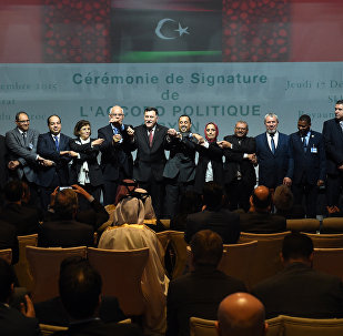 Libyan lawmakers from rival parliaments psoe for a group picture after signing a deal on a unity government on December 17, 2015, in the Moroccan city of Skhirat.