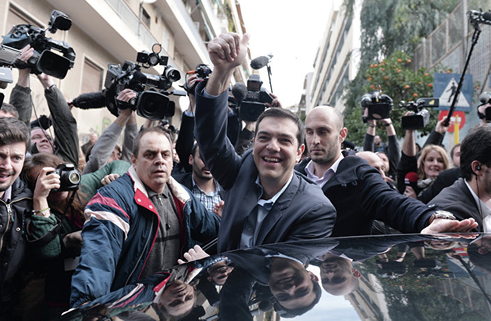 The leader of Greece's left-wing Syriza party Alexis Tsipras waves as he leaves after voting at a polling station in Athens on January, 2015.