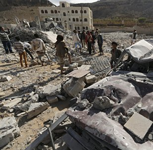 People gather at the site of a Saudi-led air strike in Yemen's capital Sanaa January 29, 2016