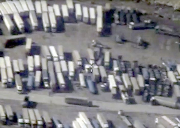 An undated still image taken from a video made available by the Russian Defense Ministry in Moscow, Russia December 2, 2015, shows the Turkish-Syrian border crossing. Russia's Defense Ministry officials displayed satellite images on Wednesday which they said showed columns of tanker trucks loading with oil at installations controlled by Islamic State in Syria and Iraq, and then crossing the border into neighboring Turkey.