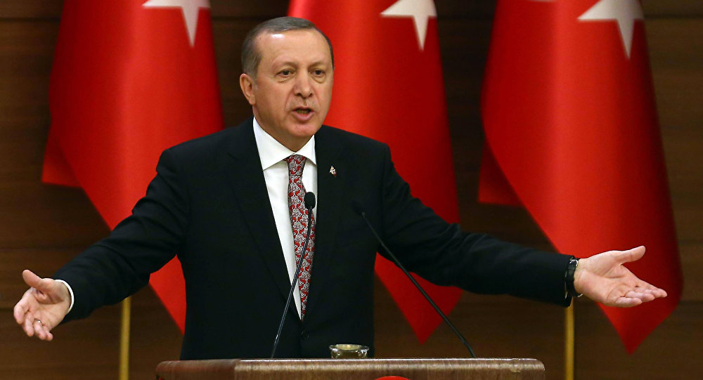 Turkey's Recep Tayyip Erdogan delivers a speech during the monthly Mukhtars meeting (local administrators) at the Presidential Complex in Ankara on February 10, 2016