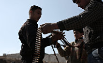 Opposition fighters belonging to Jaish al-Islam (Islam Army), the foremost rebel group in Damascus province who fiercely oppose to both the regime and the Islamic State group, check their ammunition belts in Tal al-Aswan in the area of the eastern Ghouta rebel bastion east of the Syrian capital, Damascus, during clashes with government forces on February 9, 2016.