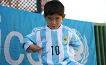 Murtaza Ahmadi can proudly show off the new signed jerseys and a football he received from UNICEF Goodwill Ambassador Leo Messi.