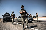 Turkish soldiers stand guar near the Turkey-Syrian border (File)