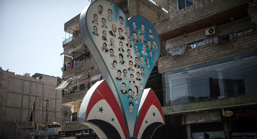 Photos of deceased residents of Damascus on a street of the city