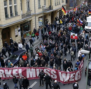 Far right-wing supporters march during rally against the German government's immigration policies and migrants, near-by the Chancellery in Berlin, Germany