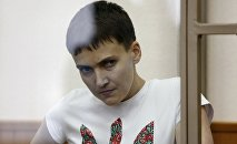 Former Ukrainian army pilot Nadezhda Savchenko looks out from a glass-walled cage as she attends a court hearing in the southern border town of Donetsk in Rostov region, Russia, in this file picture taken March 9, 2016